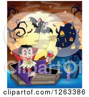 Clipart Of A Dracula Vampire Sitting In A Coffin With A Glass Of Blood With Bats Tombstones And A Haunted House Against A Full Moon Royalty Free Vector Illustration