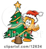 Clipart Picture Of A Price Tag Mascot Cartoon Character Waving And Standing By A Decorated Christmas Tree by Toons4Biz