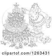 Clipart Of A Black And White Santa Standing On A Stool And Decorating A Christmas Tree Royalty Free Vector Illustration