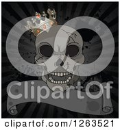 Laughing Cracked Human Skull With A Crown Over A Distressed Ribbon Banner And Rays