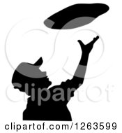 Clipart Of A Silhouetted Chef Tossing Pizza Dough Royalty Free Vector Illustration