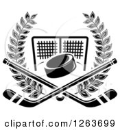 Clipart Of A Black And White Hockey Puck And Crossed Sticks Over A Goal Net In A Laurel Wreath Royalty Free Vector Illustration by Vector Tradition SM