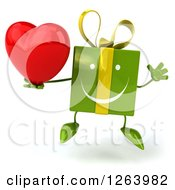 Clipart Of A 3d Green Gift Character Jumping And Holding A Red Heart Royalty Free Vector Illustration