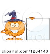 Happy Pumpkin Character Wearing A Witch Hat And Pointing To A Blank Sign by Hit Toon