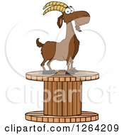 Clipart Of A Red Male Boer Goat Buck On A Giant Spool Royalty Free Vector Illustration by Hit Toon