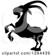 Clipart Of A Black Silhouetted Rearing Buck Goat Royalty Free Vector Illustration by Hit Toon