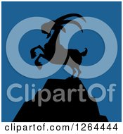 Clipart Of A Black Silhouetted Rearing Rearing Buck Goat On A Mountain Peak Over Blue Royalty Free Vector Illustration
