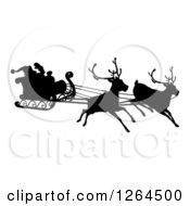 Clipart Of A Black Silhouette Of Reindeer Flying Santa In His Sleigh Royalty Free Vector Illustration