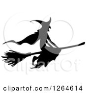 Clipart Of A Black Silhouetted Witch Flying On A Broomstick Royalty Free Vector Illustration by Vector Tradition SM