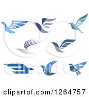 Clipart Of Flying Blue Birds Royalty Free Vector Illustration