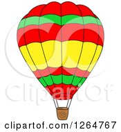 Clipart Of A Red Green And Yellow Hot Air Balloon Royalty Free Vector Illustration
