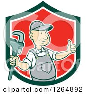 Poster, Art Print Of Cartoon Plumber Holding A Monkey Wrench And Thumb Up In A Green White And Red Shield