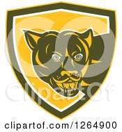 Clipart Of A Cougar In A Yellow Brown And White Shield Royalty Free Vector Illustration by patrimonio