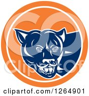 Clipart Of A Blue And White Cougar In An Orange And White Circle Royalty Free Vector Illustration by patrimonio
