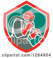 Clipart Of A Sandblaster In A Red White And Green Shield Royalty Free Vector Illustration by patrimonio
