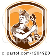 Clipart Of A Retro Female Mechanic Holding A Wrench And Rolling Up Her Sleeves In An Orange White And Brown Shield Royalty Free Vector Illustration