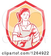 Clipart Of A Retro Female Mechanic Holding A Wrench In A Red White And Orange Shield Royalty Free Vector Illustration