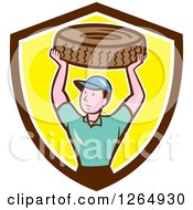 Cartoon Male Mechanic Worker Holding Up A Tire In A Brown White And Yellow Shield