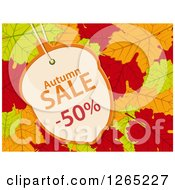 Clipart Of An Acorn Shaped Autumn Sales Discount Tag Over Fall Leaves Royalty Free Vector Illustration by elaineitalia
