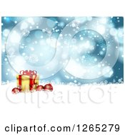 Clipart Of A Christmas Background Of 3d Baubles With A Gift Over Blue Bokeh Flares And Snowflakes Royalty Free Vector Illustration