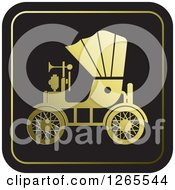 Clipart Of A Gold And Black Vintage Antique Car With A Horn Icon Royalty Free Vector Illustration