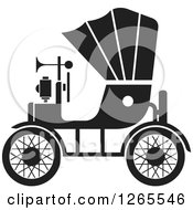 Clipart Of A Black And White Vintage Antique Car With A Horn Royalty Free Vector Illustration