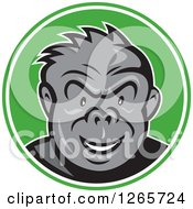 Clipart Of A Cartoon Angry Gorilla In A Green And White Circle Royalty Free Vector Illustration