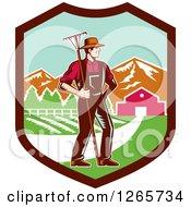 Retro Woodcut White Male Farmer With A Rake On A Farm Inside A Shield