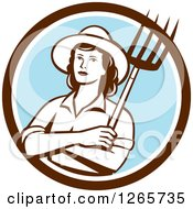 Clipart Of A Retro Female Farmer Holding A Pitchfork In A Brown White And Blue Circle Royalty Free Vector Illustration by patrimonio
