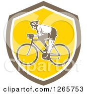 Clipart Of A Retro Male Cyclist In A Brown White And Yellow Shield Royalty Free Vector Illustration by patrimonio