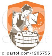Retro Housewife Woman Doing Laundry In A Brown And Orange Shield