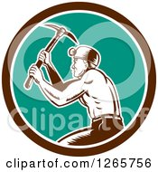 Clipart Of A Retro Woodcut Miner Working With A Pickaxe In A Brown White And Turquoise Circle Royalty Free Vector Illustration