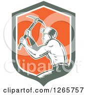 Clipart Of A Retro Woodcut Miner Working With A Pickaxe In A Green White And Orange Shield Royalty Free Vector Illustration