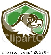 Clipart Of A Retro Falcon Head In A Brown White And Green Shield Royalty Free Vector Illustration by patrimonio