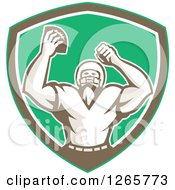 Clipart Of A Retro Cheering American Football Player In A Green Brown And White Shield Royalty Free Vector Illustration by patrimonio