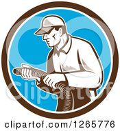 Clipart Of A Retro Male Home Insulation Worker Holding A Hose In A Brown White And Blue Circle Royalty Free Vector Illustration