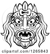 Clipart Of A Black And White Tribal Mask Royalty Free Vector Illustration