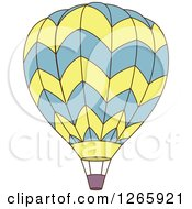 Clipart Of A Blue And Yellow Hot Air Balloon Royalty Free Vector Illustration