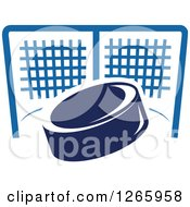 Clipart Of A Blue Hockey Puck And Net Royalty Free Vector Illustration