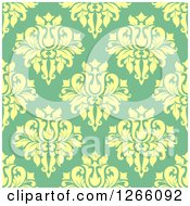 Clipart Of A Seamless Pattern Background Of Vintage Yellow Floral Damask On Green Royalty Free Vector Illustration