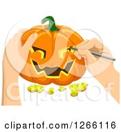 Clipart Of Hands Carving A Halloween Jackolantern Pumpkin Royalty Free Vector Illustration