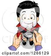 Clipart Of A Mothers Hands Painting A Vampire Face On Her Son For Halloween Royalty Free Vector Illustration