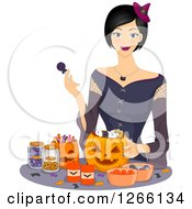 Clipart Of A Young Asian Woman Dressed As A Witch Filling Halloween Pumpkins With Candy Royalty Free Vector Illustration