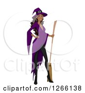 Clipart Of A Black Witch Woman Posing With A Broom Royalty Free Vector Illustration