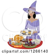 Clipart Of A Pretty Young Black Woman Dressed As A Witch Setting Up Halloween Party Snacks Royalty Free Vector Illustration