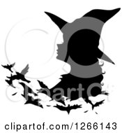 Clipart Of A Black Silhouetted Witch Changing Into Birds Royalty Free Vector Illustration by BNP Design Studio
