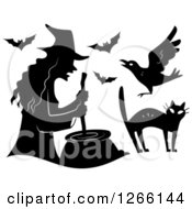 Clipart Of A Black Silhouetted Witch Stirring A Cauldron With Bats A Crow And Cat Royalty Free Vector Illustration by BNP Design Studio