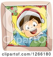 Clipart Of A Happy Caucasian Boy Wearing A Santa Hat And Looking Down Into A Christmas Gift Box Royalty Free Vector Illustration