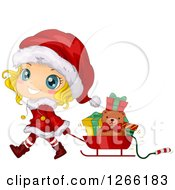 Cute Blond White Toddler Girl Wearing A Santa Suit And Pulling Christmas Gifts In A Sleigh