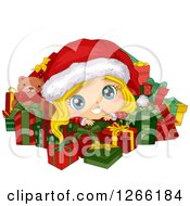 Cute Blond White Toddler Girl Wearing A Santa Hat And Resting On Top Of Christmas Gifts